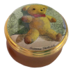 "Teddy in Green Chair (15/0564)1.25"" diameter. Inside Lid: Drawing/painting of the back of a Teddy Bear."