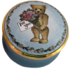 "Teddy ""For You"" (15/) 1.25"" diameter. Inside Lid: Black & White painting of a bouquet of flowers."