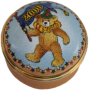 "Millennium Teddy (Dated 2000) (15/6167) 1.25"" diameter. Inside Lid: Drawing of Teddy on top of the world"