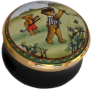 "Teddy Golf (15/3827) 1.25"" diameter. Inside Lid: Painting/drawing of a Teddy with a golf club."